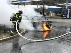 Lt. David Parks attacks a car fire Saturday in Taylorsville. Photo courtesy of German Township Fire Department.